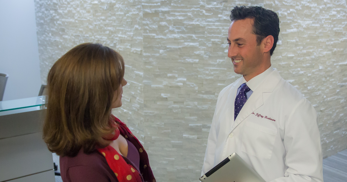 Dr. Rockmore greeting plastic surgery patient in Albany