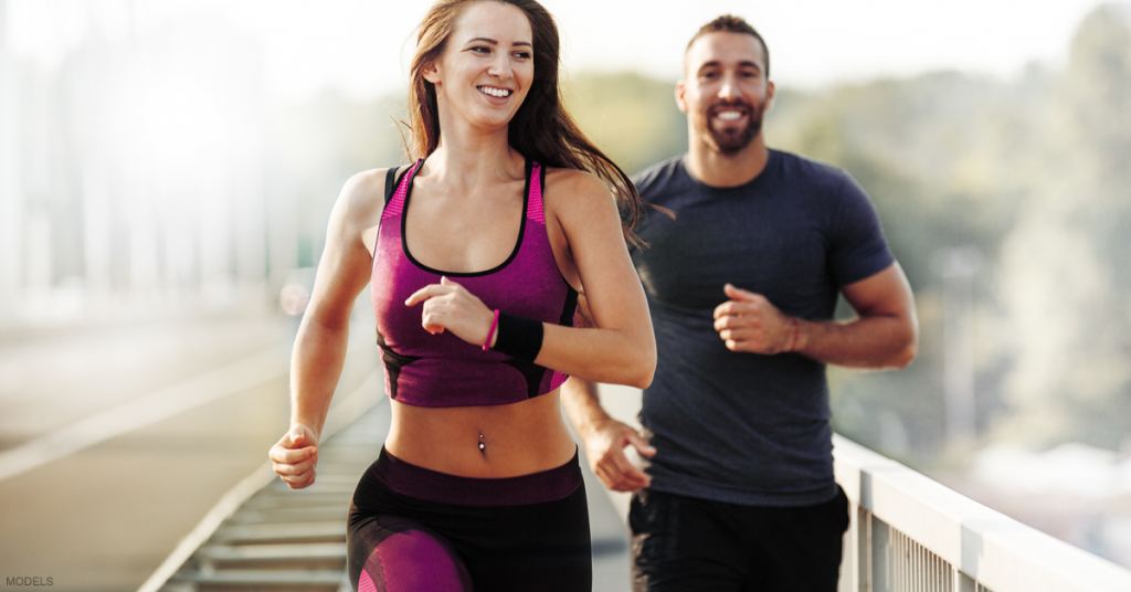 A woman and man go on a jog to prepare for their liposuction procedures.