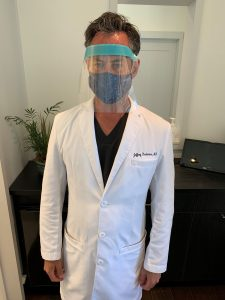 Dr Jeffrey Rockmore wearing PPE