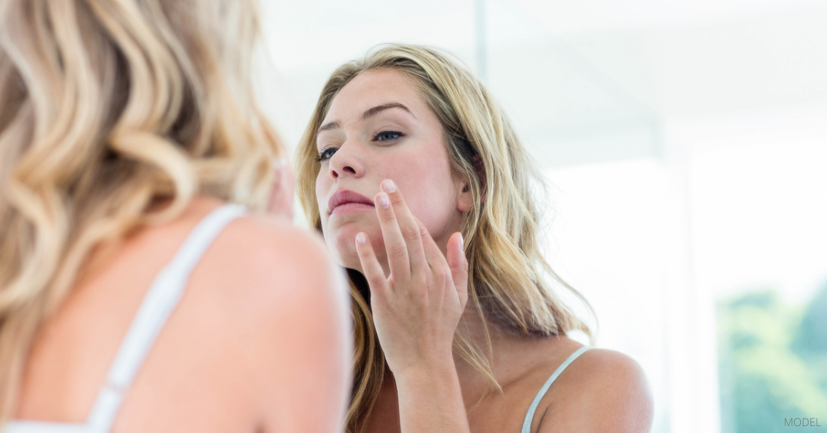 A woman maintaining optimal skin health after reading Dr. Rockmore's blog.